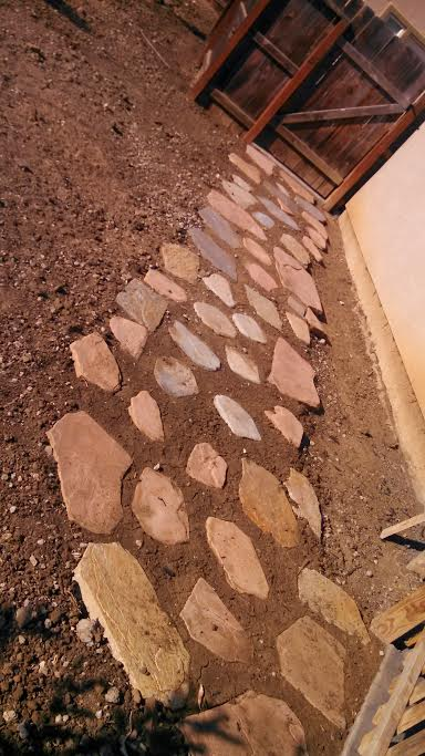 The photo shows the finished flagstone patio work in Diamond Bar