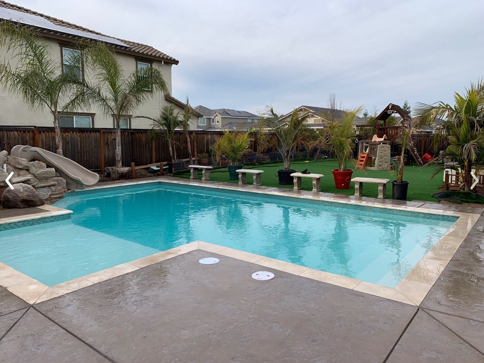 The photo shows the finished pool deck work in Diamond Bar.