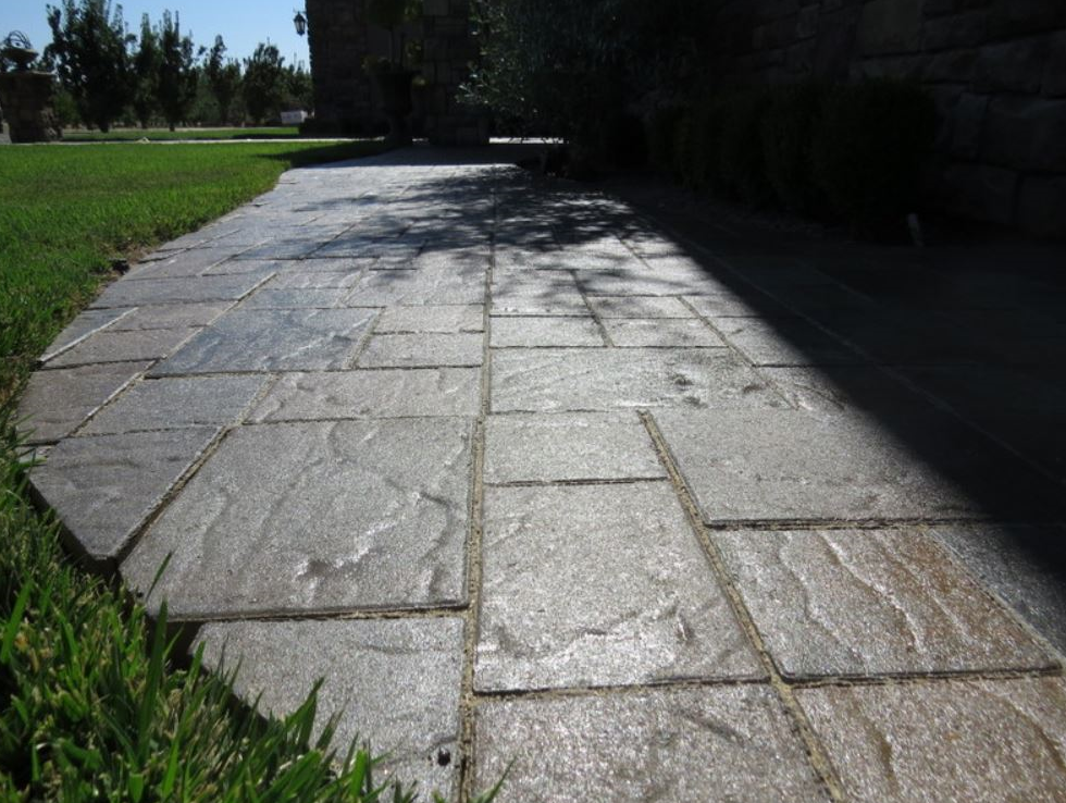 The photo shows the finished stamped concrete work in Diamond Bar.