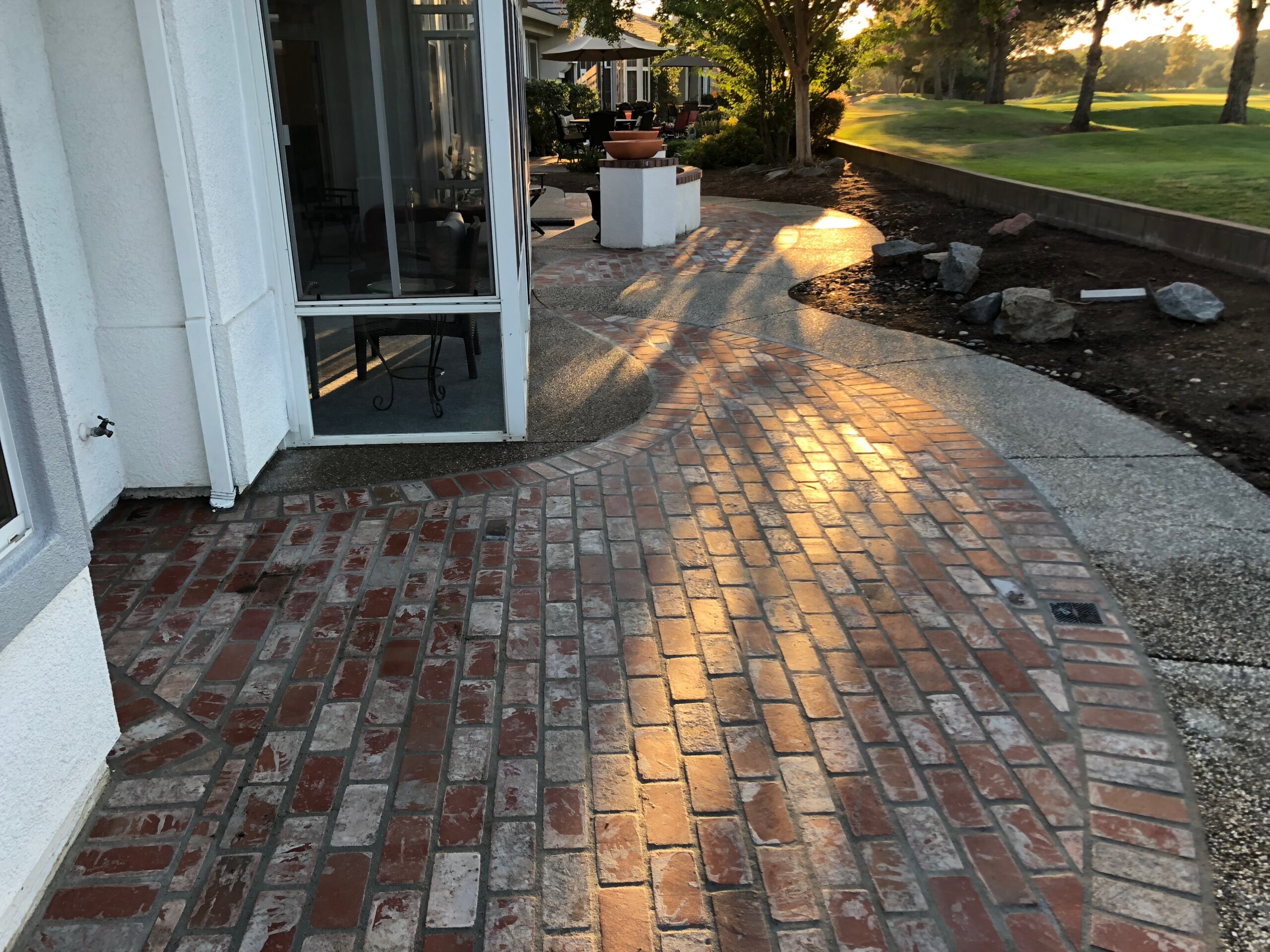 The photo shows the finished stamped patio work in Diamond Bar.